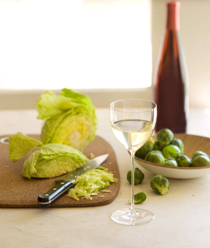 Still life with white wine and vegetables